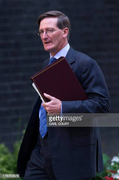 Britain's Attorney General Dominic Grieve arrives in Downing Street ahead of a meeting of the National Security Council in central London on August...