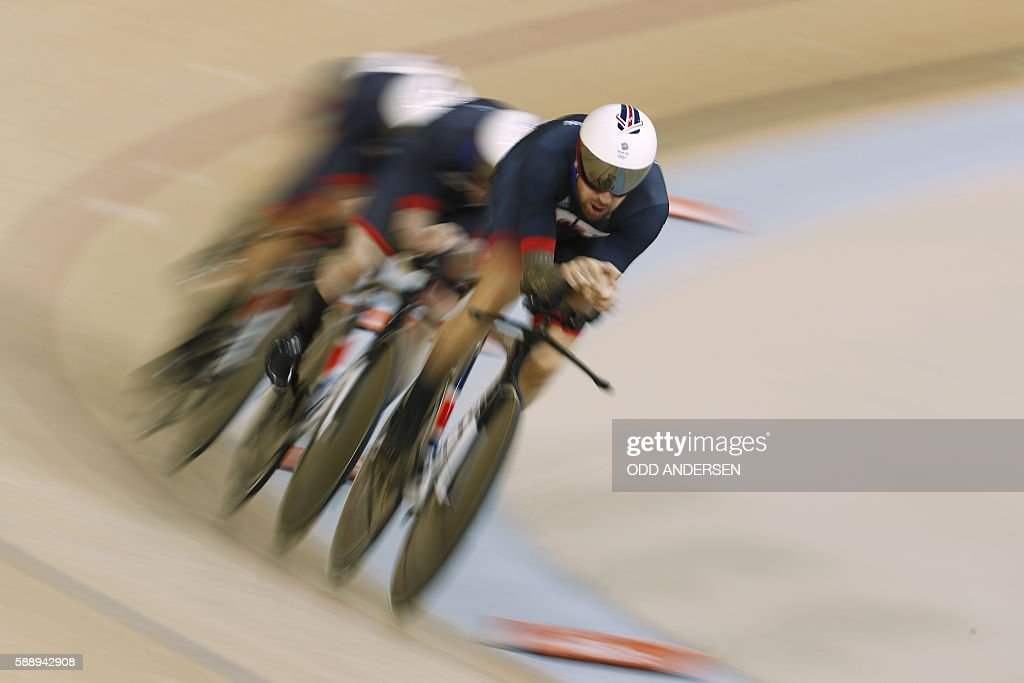 TOPSHOT Britain's Bradley Wiggins Britain's Owain Doull Britain's Edward Clancy and Britain's Steven Burke compete in the men's Team Pursuit finals...