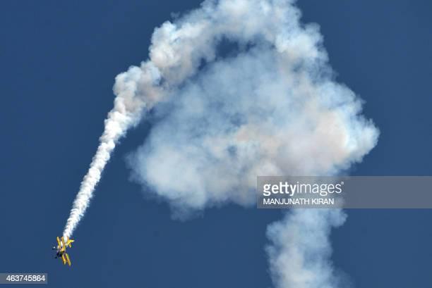 Britain's Breitling SkyWalkers Aerobatic Team perform aerial stunts atop Boeing Stearman Biplanes at Yelahanka Airforce Station in Bangalore on...