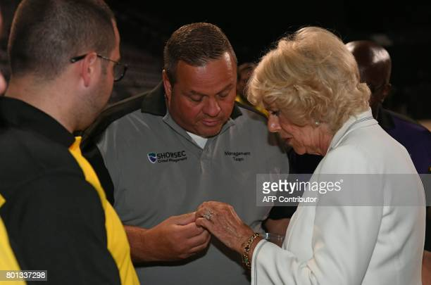 Britain's Camilla Duchess of Cornwall is presented with a broach in the shape of a Bee at Manchester Arena in Manchester north west England on June...