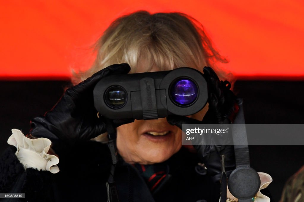 Britain's Camilla, Duchess of Cornwall looks through a rangefinder as she is introduced to various pieces of military kit by British soldiers from R Company, 4th Battalion, The Rifles (4 RIFLES), during a visit at Ward Barracks in Bulford, Wiltshire on January 29, 2013. The Duchess of Cornwall, Royal Colonel, 4th Battalion, The Rifles, visited the battalion during their pre-deployment training. AFP PHOTO / POOL / BEN BIRCHALL