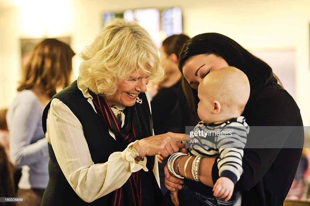 Britain's Camilla, Duchess of Cornwall meets baby Corey Wilmott, 6 months old, and his mum Natalie, whose husband Sergeant Gavin Wilmott is serving with the 4th Battalion, The Rifles during a visit at Ward Barracks in Bulford, Wiltshire on January 29, 2013. The Duchess of Cornwall, Royal Colonel, 4th Battalion, The Rifles, (4 RIFLES), visited the Battalion during their pre-deployment training. AFP PHOTO / POOL / BEN BIRCHALL