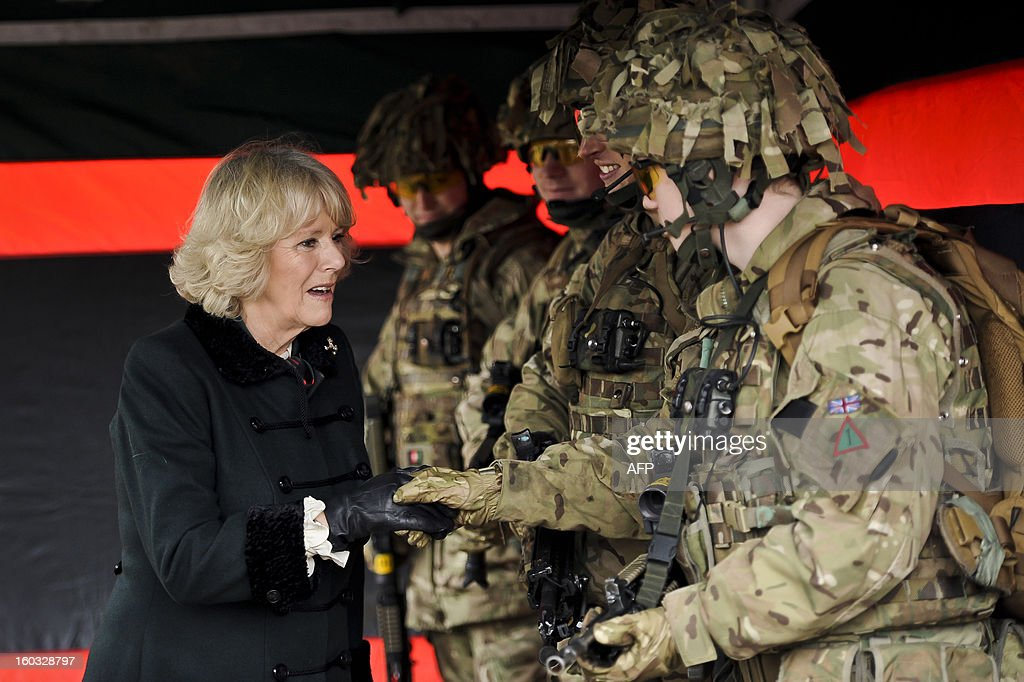 Britain's Camilla, Duchess of Cornwall meets British soldiers from R Company, 4th Battalion, The Rifles (4 RIFLES), during a visit at Ward Barracks in Bulford, Wiltshire on January 29, 2013. The Duchess of Cornwall, Royal Colonel, 4th Battalion, The Rifles, visited the battalion during their pre-deployment training. AFP PHOTO / POOL / BEN BIRCHALL
