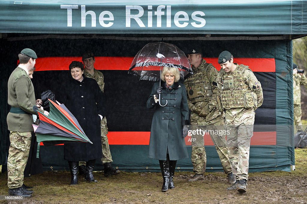 Britain's Camilla, Duchess of Cornwall meets British soldiers from R Company, 4th Battalion, The Rifles (4 RIFLES), during a visit at Ward Barracks in Bulford, Wiltshire on January 29, 2013. The Duchess of Cornwall, Royal Colonel, 4th Battalion, The Rifles, visited the battalion during their pre-deployment training.
