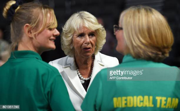 Britain's Camilla Duchess of Cornwall meets medical and security staff at the Manchester Arena in Manchester north west England on June 26 who helped...
