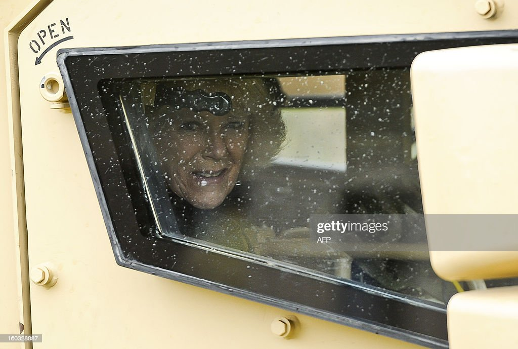 Britain's Camilla, Duchess of Cornwall peers through the bullet proof glass window of a Husky armoured vehicle driven by a British soldier from R Company, 4th Battalion, The Rifles (4 RIFLES), during a visit at Ward Barracks in Bulford, Wiltshire on January 29, 2013. The Duchess of Cornwall, Royal Colonel, 4th Battalion, The Rifles, visited the battalion during their pre-deployment training.
