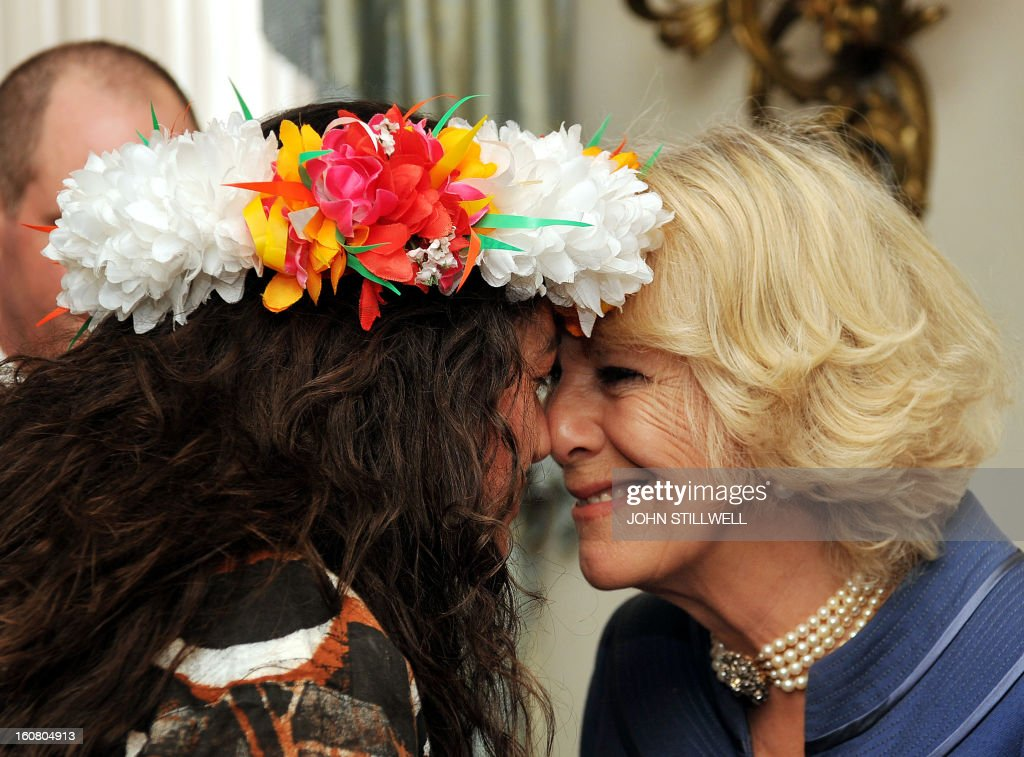 Britain's Camilla, Duchess of Cornwall receives a traditional Maori welcome, a hongi, from Newzealand artist Rosanna Raymond, who is wearing a Tuvalu floral headdress made from silk flowers, during a reception for finalists and past winners of 'New Zealander and Australian of the year' at Clarence House in central London on February 6, 2013. The Australia Day Foundation and the New Zealand Society UK, annually present awards to people in the UK who have most advanced the interests of their respective countries in the previous year. AFP PHOTO / POOL / JOHN STILLWELL