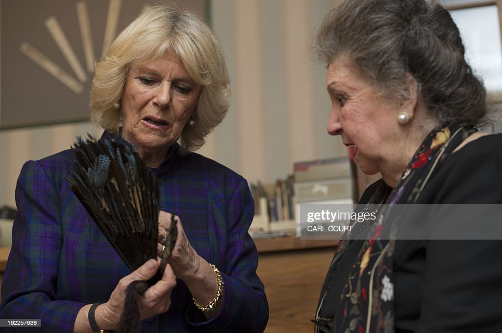 Britain's Camilla, Duchess of Cornwall, shows her great grandmother's broken feather fan to museum director and founder, Helene Alexander (R), before leaving it with staff to be repaired during a visit to the Fan Museum in Greenwich, south-east London on February 21, 2013. The Fan Museum is the UK's only museum devoted in its entirety to all aspects of the ancient art and craft of the fan.