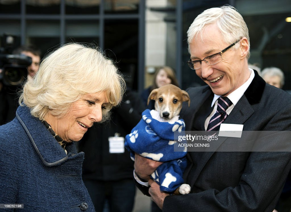 Britain's Camilla, Duchess of Cornwall, stands next to television presenter Paul O'Grady during a visit to the Battersea Dogs & Cats Home in London on December 12, 2012. Earlier in the year The Duchess rehomed Bluebell, a Jack Russell Terrier that was found astary in a London park.