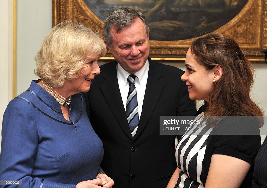 Britain's Camilla, Duchess of Cornwall (L) talks with guest Rebecca Richards watched by Australian High Commissioner to London Mike Rann (C) during a reception for finalists and past winners of 'New Zealander and Australian of the year' at Clarence House in central London on February 6, 2013. The Australia Day Foundation and the New Zealand Society UK, annually present awards to people in the UK who have most advanced the interests of their respective countries in the previous year.