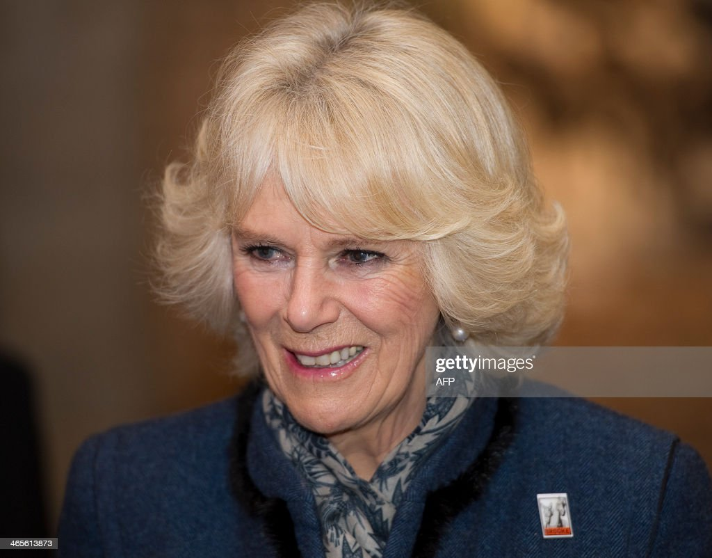 Britain's Camilla Duchess of Cornwall views 'The Brooke through a lens' exhibition at an event to mark the 80th anniversary of the animal welfare...