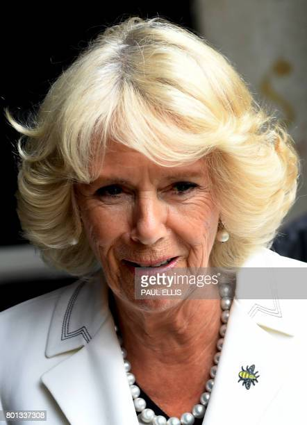 Britain's Camilla Duchess of Cornwall wears a broach in the shape of a Bee as she leaves the Manchester Arena in Manchester north west England on...