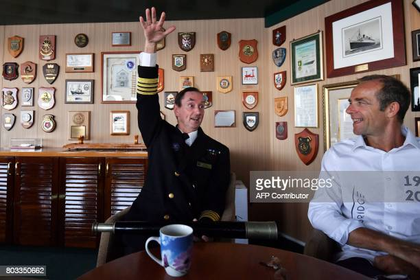 Britain's captain Christopher Wells gestures as he speaks with The Bridge 2017 organiser Damien Grimont in the command bridge of the Cunard cruise...