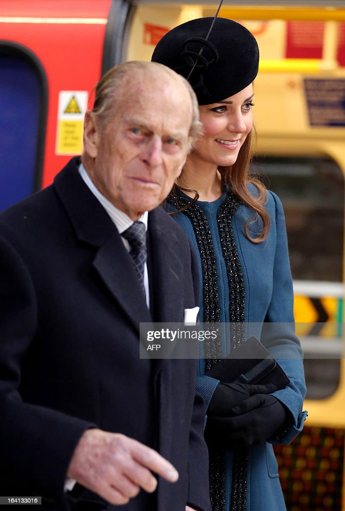 Britain's Catherine, Duchess of Cambridge, and Britain's Prince Philip, Duke of Edinburgh, visit Baker Street tube station with Britain's Queen Elizabeth II (unseen) in London on March 20, 2013 to mark 150th anniversary of the London underground.