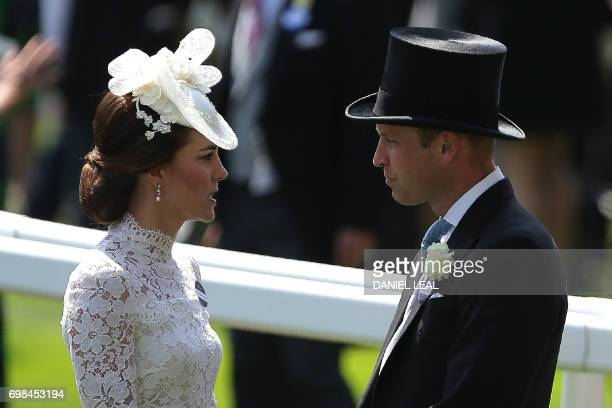 TOPSHOT Britain's Catherine Duchess of Cambridge and Britain's Prince William Duke of Cambridge attend day one of the Royal Ascot horse racing meet...