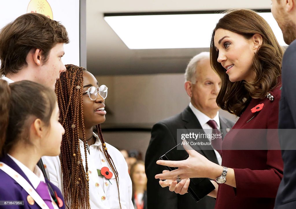 Britain's Catherine, Duchess of Cambridge and patron of national children's mental health charity Place2Be, meets pupils from The Bridge Academy at the annual Place2Be School Leaders Forum in London on November 8, 2017. / AFP PHOTO / POOL / John Phillips