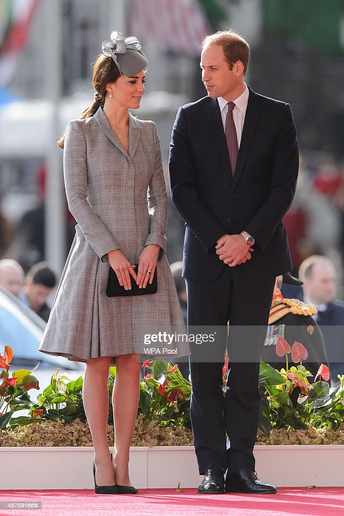 Britain's Catherine, Duchess of Cambridge (L) and Prince William, Duke of Cambridge (R) attend the ceremonial welcome ceremony for Singapore's President Tony Tan Keng Yam at the start of a state visit at Horse Guards Parade on October 21, 2014 in London, England. The President is at the beginning of his four day stay during which he will hold a bilateral meeting with Prime Minister David Cameron.