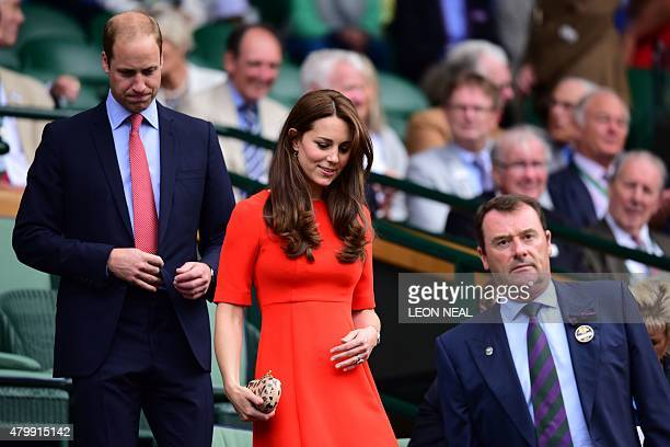 Britain's Catherine Duchess of Cambridge and Prince William Duke of Cambridge take their seats with Philip Brook chairman of the All England Club in...