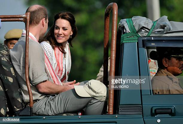 Britain's Catherine Duchess of Cambridge and Prince William Duke of Cambridge arrive for a safari through Kaziranga National Park on the fourth day...
