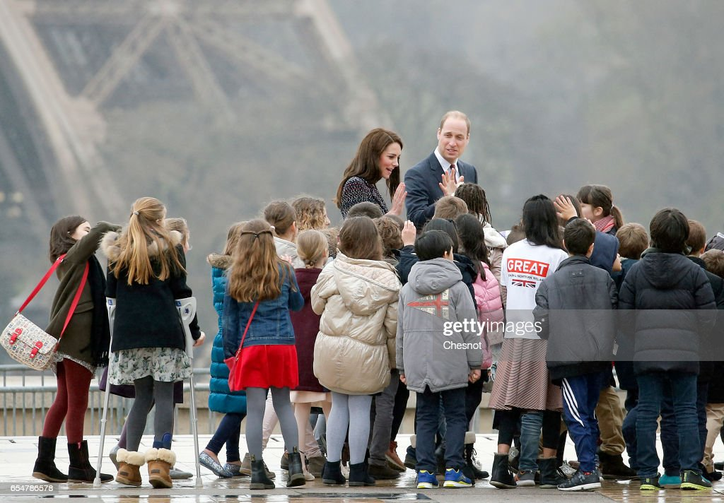 Britain's Catherine, Duchess of Cambridge and Prince William, Duke of Cambridge meet young people at the Trocadero square near the Eiffel Tower on March 18, 2017 in Paris, France. The Duke and Duchess of Cambridge are on an official two-day visit to Paris.