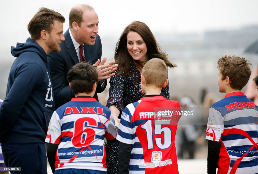 Britain's Catherine, Duchess of Cambridge and Prince William, Duke of Cambridge meet young French rugby fans at the Trocadero square near the Eiffel Tower on March 18, 2017 in Paris, France. The Duke and Duchess of Cambridge are on an official two-day visit to Paris.