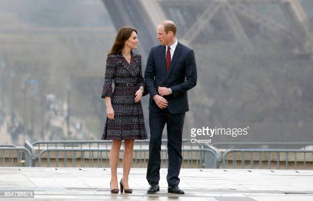 Britain's Catherine Duchess of Cambridge and Prince William Duke of Cambridge pose at Trocadero square in front of the Eiffel tower the Eiffel Tower...