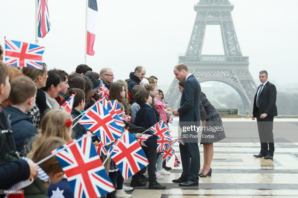 Britain's Catherine, Duchess of Cambridge and Prince William, Duke of Cambridge meet people at the Trocadero square near the Eiffel Tower on March 18, 2017 in Paris, France. The Duke and Duchess are on a two day tour of France.
