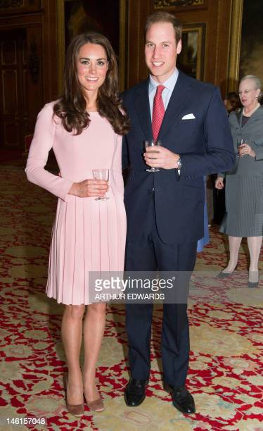 Britain's Catherine Duchess of Cambridge and Prince William stand together during a reception ahead of a sovereign's jubilee lunch hosted by...