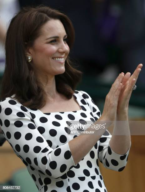 Britain's Catherine Duchess of Cambridge applauds after Czech Republic's Petra Kvitova won against Sweden's Johanna Larsson during their women's...