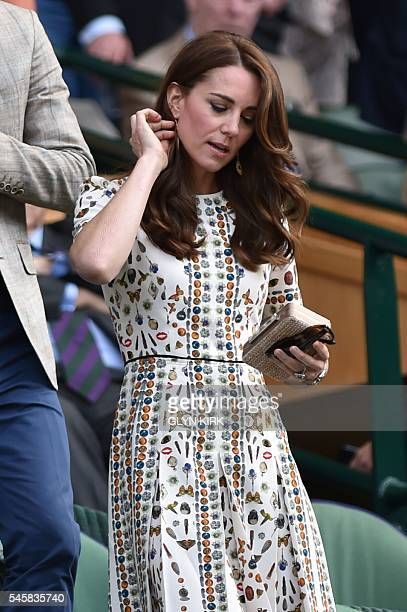 Britain's Catherine Duchess of Cambridge arrive in the royal box on centre court for the men's singles final match on the last day of the 2016...