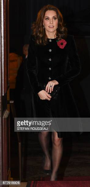 Britain's Catherine Duchess of Cambridge arrives for the the annual Royal Festival of Remembrance at the Royal Albert Hall in London on November 11...
