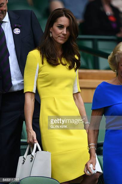 Britain's Catherine Duchess of Cambridge arrives in the royal box on centre court during the women's semifinal matches on the eleventh day of the...
