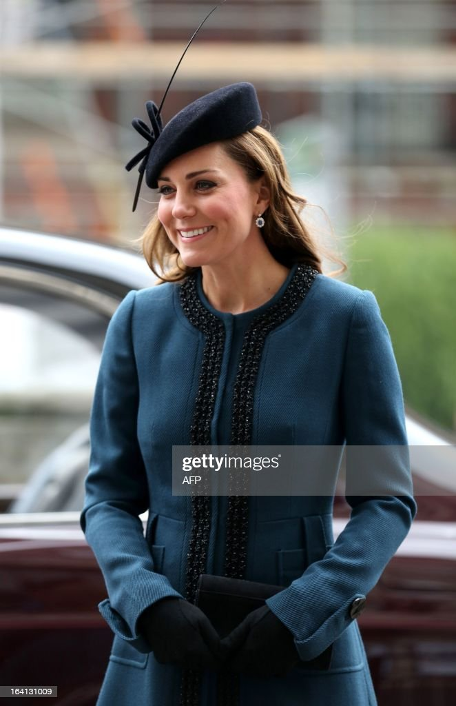 Britain's Catherine, Duchess of Cambridge, arrives to visit to Baker Street tube station with Queen Elizabeth II and Prince Philip, Duke of Edinburgh, in London on March 20, 2013 to mark 150th anniversary of the London underground. The 86-year-old queen attended her first public engagement for more than a week after she had to cancel a number of events last week as she was still recovering from a bout of gastroenteritis which saw her admitted to hospital on March 3 for the first time in ten years.