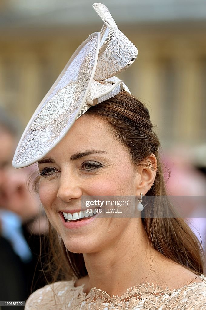Britain's Catherine Duchess of Cambridge attends a garden party at Buckingham Palace in London on June 10 2014 AFP PHOTO / POOL / JOHN STILLWELL