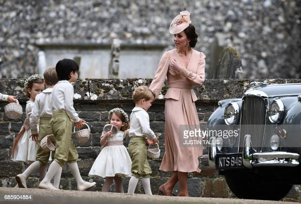 TOPSHOT Britain's Catherine Duchess of Cambridge beckons the bridesmaids and pageboys including Britain's prince George and Britain's princess...