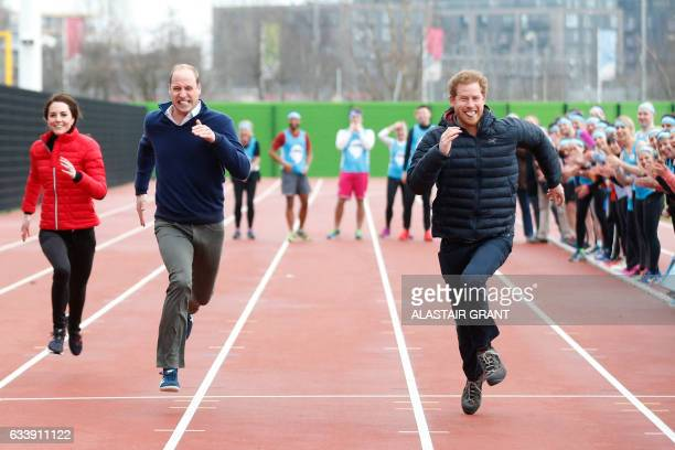 Britain's Catherine Duchess of Cambridge Britain's Prince William Duke of Cambridge and Britain's Prince Harry take part in a relay race during a...