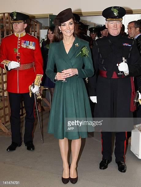 Britain's Catherine Duchess of Cambridge holds a glass of Harvey's Bristol Creme in the Junior's Mess as she visits Aldershot Barracks on St...