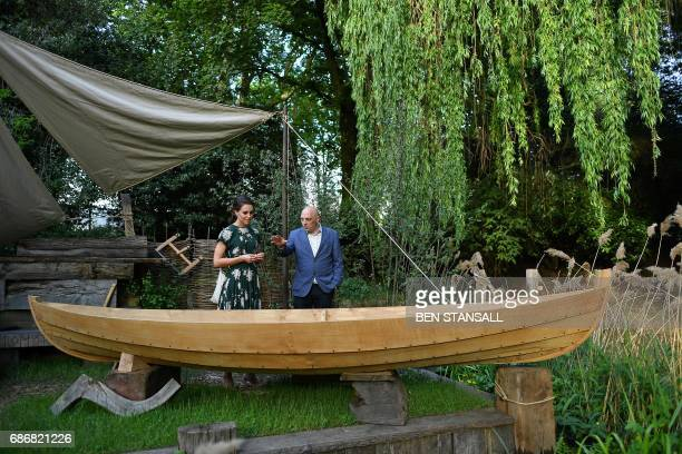 Britain's Catherine Duchess of Cambridge is shown the IBTC Lowestoft Broadland Boatbuilder's Garden as she visits the Chelsea Flower Show in London...