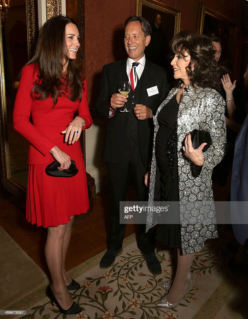 Britain's Catherine, Duchess of Cambridge (L) meets British actress Joan Collins (R) and Swaziland born actor Richard E. Grant (C) during a Reception for the Dramatic Arts, at Buckingham Palace in London, on February 17, 2014.
