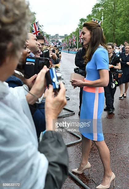 Britain's Catherine Duchess of Cambridge meets guests at the Patron's Lunch a special street party outside Buckingham Palace in London on June 12 as...