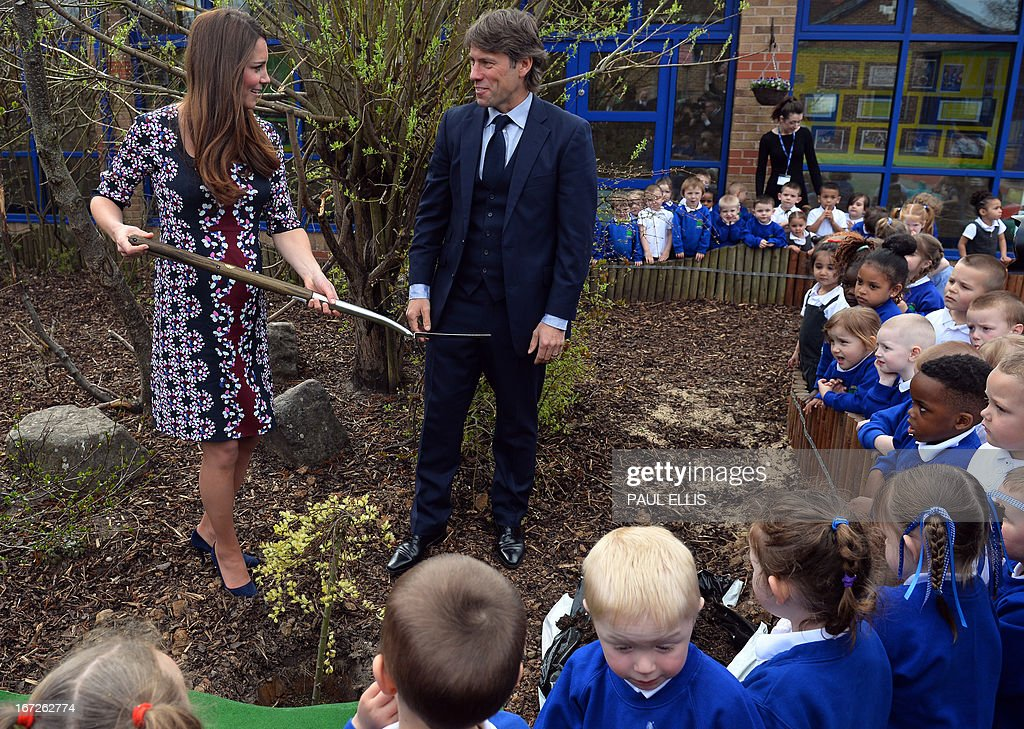 Britain's <a gi-track='captionPersonalityLinkClicked' href=/galleries/search?phrase=Catherine+-+Duchess+of+Cambridge&family=editorial&specificpeople=542588 ng-click='$event.stopPropagation()'>Catherine</a>, Duchess of Cambridge (L), plants a willow tree with comedian <a gi-track='captionPersonalityLinkClicked' href=/galleries/search?phrase=John+Bishop+-+Actor&family=editorial&specificpeople=7360807 ng-click='$event.stopPropagation()'>John Bishop</a> (R) during her visit to The Willows Primary School, Wythenshawe, Manchester, northwest England on April 23, 2013 to launch a new school counselling programme. The duchess of Cambridge met staff and volunteers, teachers and parents at the school as she launched the programme, which is a partnership between the Royal Foundation, Comic Relief, Place2Be and Action on Addiction.