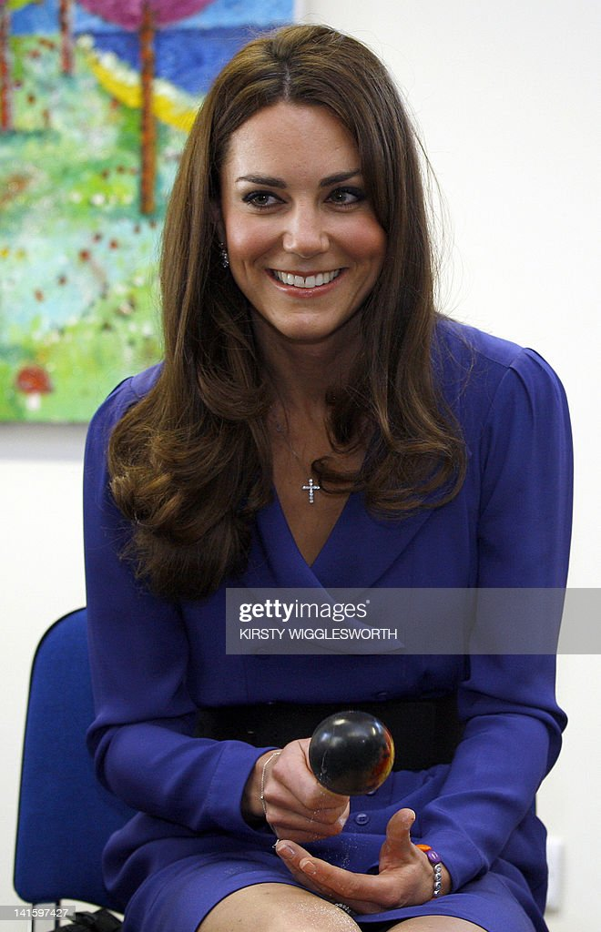 Britain's <a gi-track='captionPersonalityLinkClicked' href=/galleries/search?phrase=Catherine+-+Duchess+of+Cambridge&family=editorial&specificpeople=542588 ng-click='$event.stopPropagation()'>Catherine</a>, Duchess of Cambridge plays the maracas during a visit to The Treehouse in Ipswich, eastern England, on March 19, 2012. The Duchess of Cambridge visited to formally opened The Treehouse, a children's hospice service for the counties of Suffolk and Essex. AFP PHOTO / POOL / KIRSTY WIGGLESWORTH