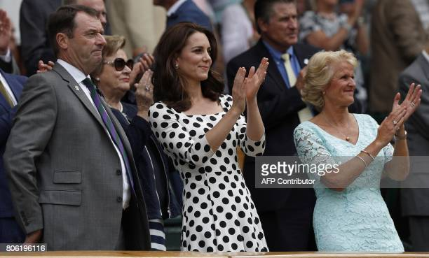 Britain's Catherine Duchess of Cambridge reacts after Britain's Andy Murray won against Kazakhstan's Alexander Bublik during their men's singles...