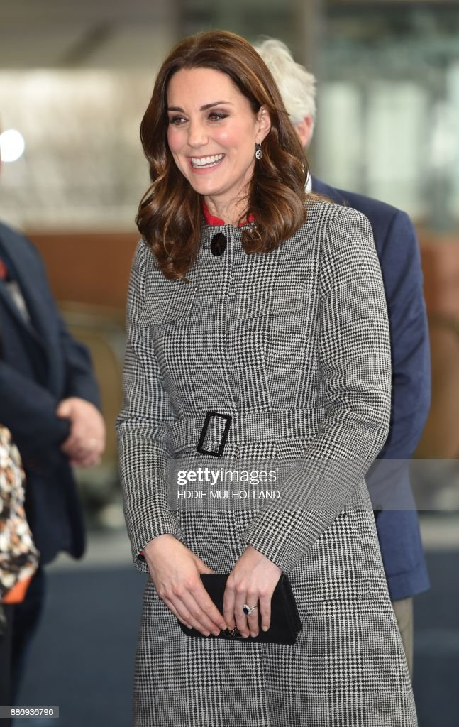 Britain's Catherine, Duchess of Cambridge reacts as she arrives to attend the Children's Global Media Summit at the Manchester Central Convention Complex in Manchester, north-west England, on December 6, 2017. The Duke and Duchess of Cambridge attended the Children's Global Media Summit, where the Duke gave a key note speech, and the Duchess joined a forum hosted by Sesame Street's Workshop, the charitable foundation of the famous children's TV show, on research commissioned into kindness. / AFP PHOTO / POOL / Eddie MULHOLLAND