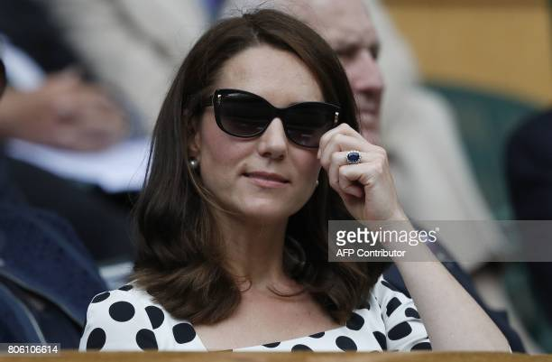 Britain's Catherine Duchess of Cambridge reacts as she watches Britain's Andy Murray and Kazakhstan's Alexander Bublik during their men's singles...