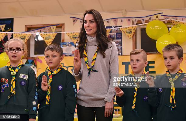 Britain's Catherine Duchess of Cambridge reads the Scouts promise during a Cub Scout Pack meeting with cubs from the Kings Lynn District in Kings...