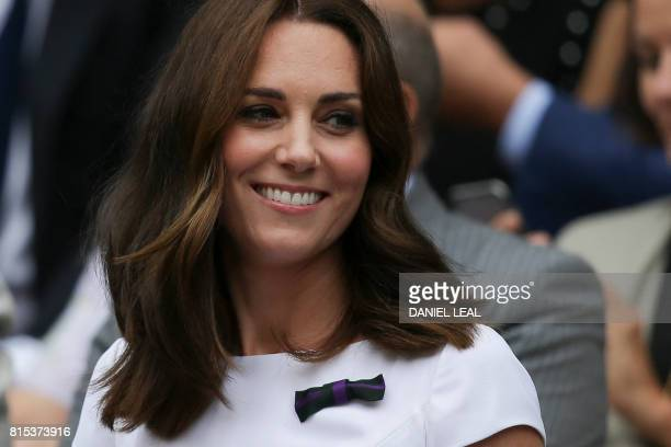 Britain's Catherine Duchess of Cambridge sitsin the Royal box on Centre Court for the men's singles final match on the last day of the 2017 Wimbledon...