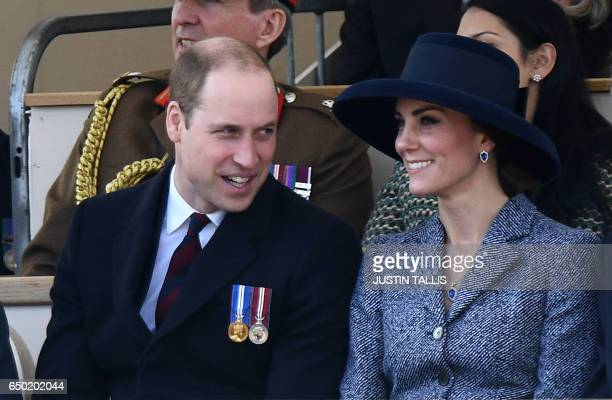 Britain's Catherine Duchess of Cambridge smiles a she talks to Britain's Prince William Duke of Cambridge as they attend a Service of Commemoration...