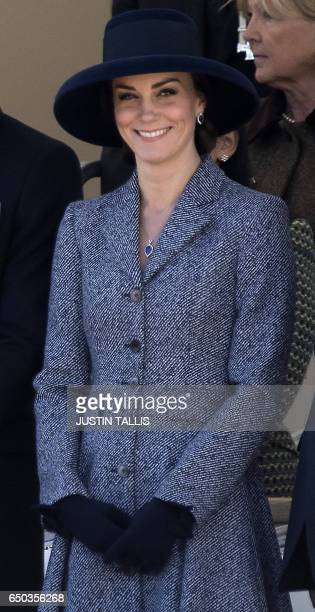 Britain's Catherine Duchess of Cambridge smiles as she attends a Service of Commemoration and Drumhead Service on Horse Guards Parade in central...