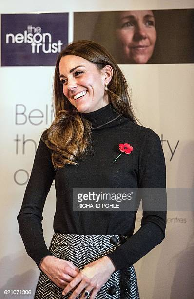 Britain's Catherine Duchess of Cambridge smiles on a visit to the Nelson trust women centre in Gloucester western England on November 4 2016 The...